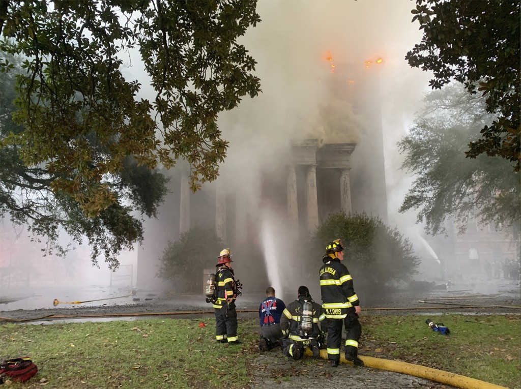 This photo provided by Columbia Fire Department, firefighters battle a blaze at Babcock Building in Columbia, S.C., on Saturday, Sept. 12, 2020.  Offi...