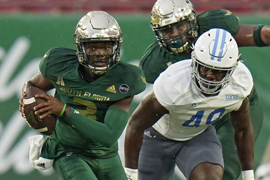South Florida quarterback Jordan McCloud (3) breaks away from Citadel linebacker Marquise Blount (49) during the first half of an NCAA college footbal...