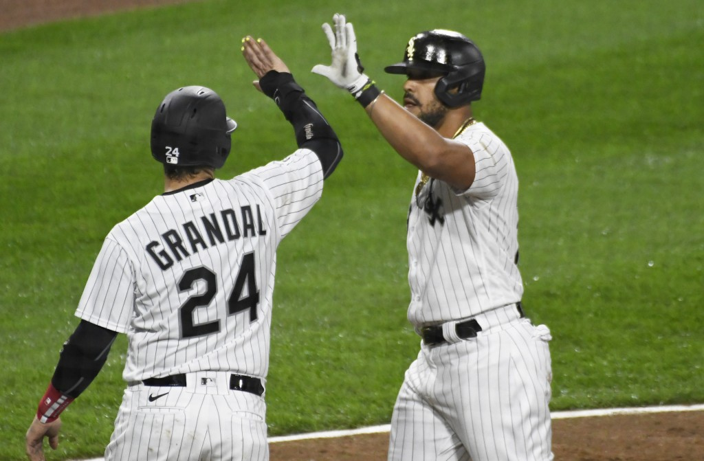 Chicago White Sox's Jose Abreu (79) is greeted by Yasmani Grandal (24) after hitting a three-run home run against the Detroit Tigers during the fifth ...