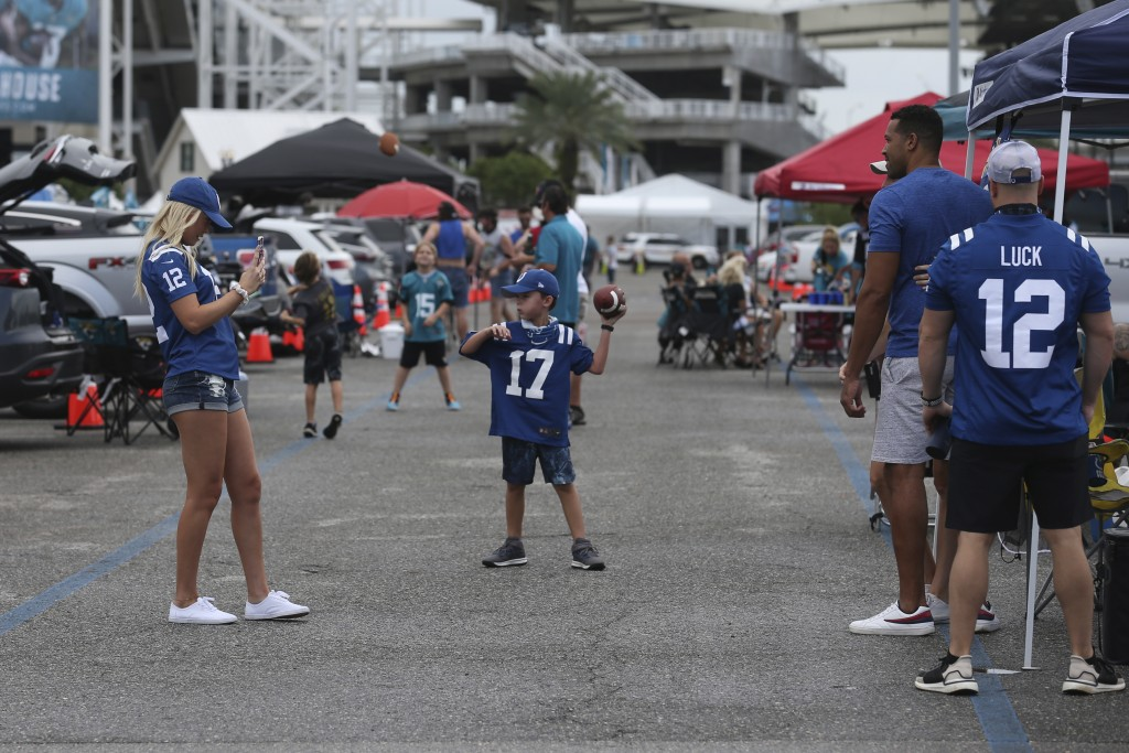Fans tailgate before an NFL football game between the Jacksonville Jaguars and the Indianapolis Colts, Sunday, Sept. 13, 2020, in Jacksonville, Fla. (...