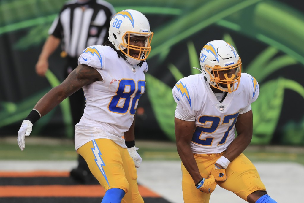 Los Angeles Chargers running back Joshua Kelley (27) celebrates with Virgil Green (88) after Kelley rushed for a touchdown during the second half of a...