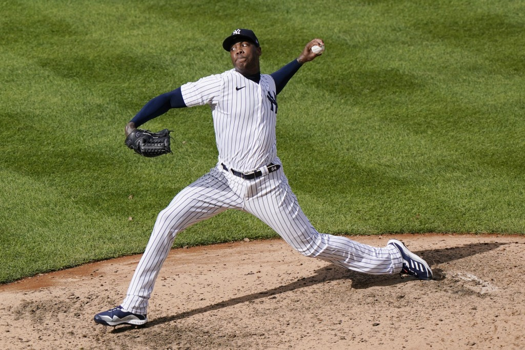 New York Yankees relief pitcher Aroldis Chapman winds up during the ninth inning of a baseball game against the Baltimore Orioles, Sunday, Sept. 13, 2...