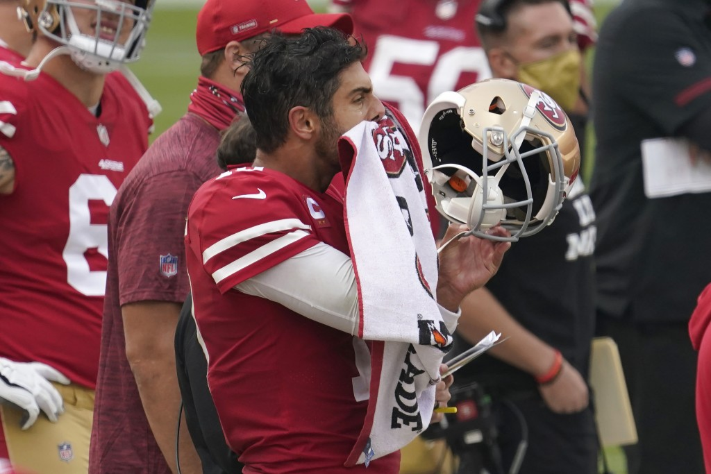 San Francisco 49ers quarterback Jimmy Garoppolo reacts on the sideline during the second half of an NFL football game against the Arizona Cardinals in...