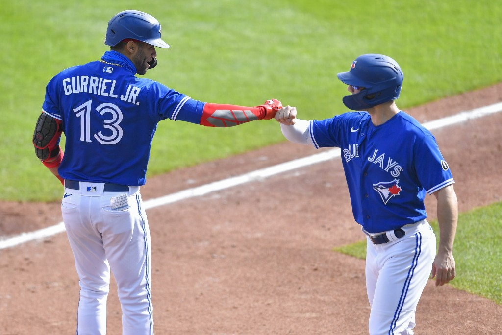 Toronto Blue Jays' Lourdes Gurriel Jr., left, and Randal Grichuk, right, celebrate after scoring on Gurriel Jr.'s two-run home run against the New Yor...