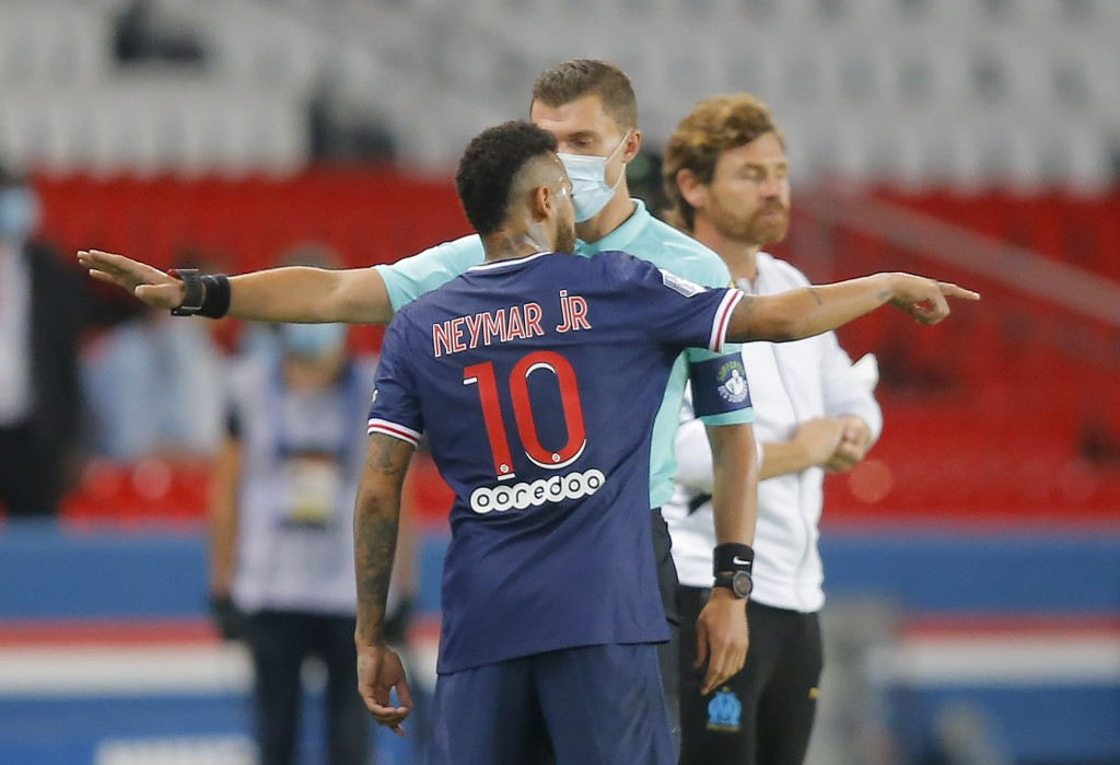 PSG's Neymar argues with the fourth official as he leaves the pitch after getting a red card during the French League One soccer match between Paris S...