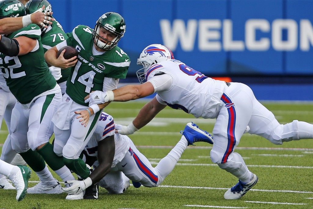 New York Jets quarterback Sam Darnold (14) is sacked by Buffalo Bills defensive end Mario Addison (97), center rear, and Harrison Phillips, right, dur...