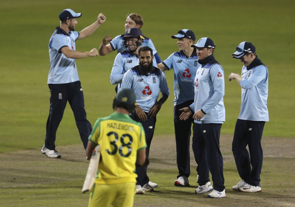 England's Adil Rashid, fourth left, celebrates with teammates after taking the wicket of Australia's Alex Carey to win the second ODI cricket match be...