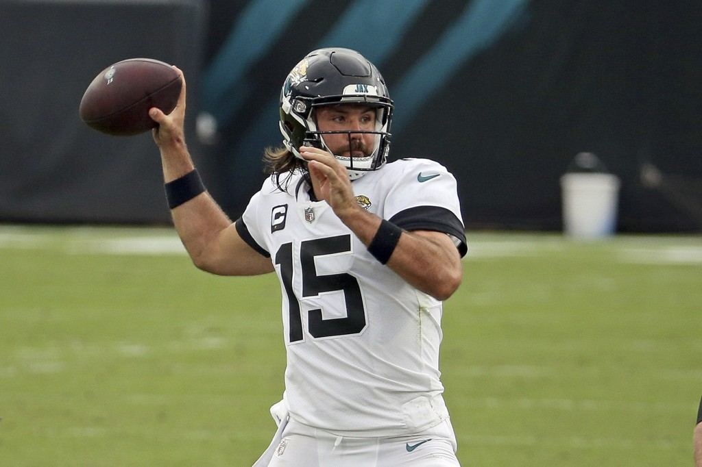 Jacksonville Jaguars quarterback Gardner Minshew (15) throws a pass against the Indianapolis Colts during the first half of an NFL football game, Sund...
