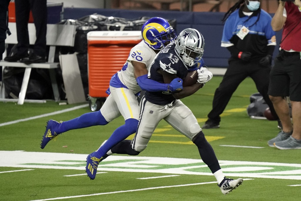 Dallas Cowboys wide receiver Michael Gallup (13) makes a catch but is called for offensive pass interference on Los Angeles Rams cornerback Jalen Rams...