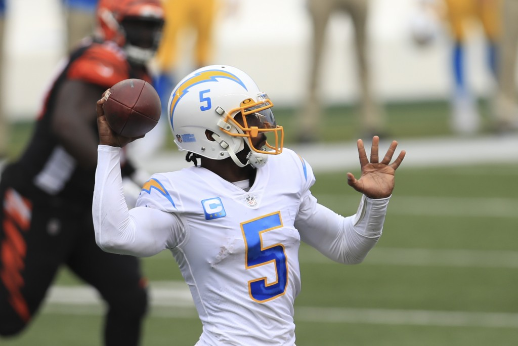 Los Angeles Chargers quarterback Tyrod Taylor (5) throws during the first half of an NFL football game against the Cincinnati Bengals, Sunday, Sept. 1...