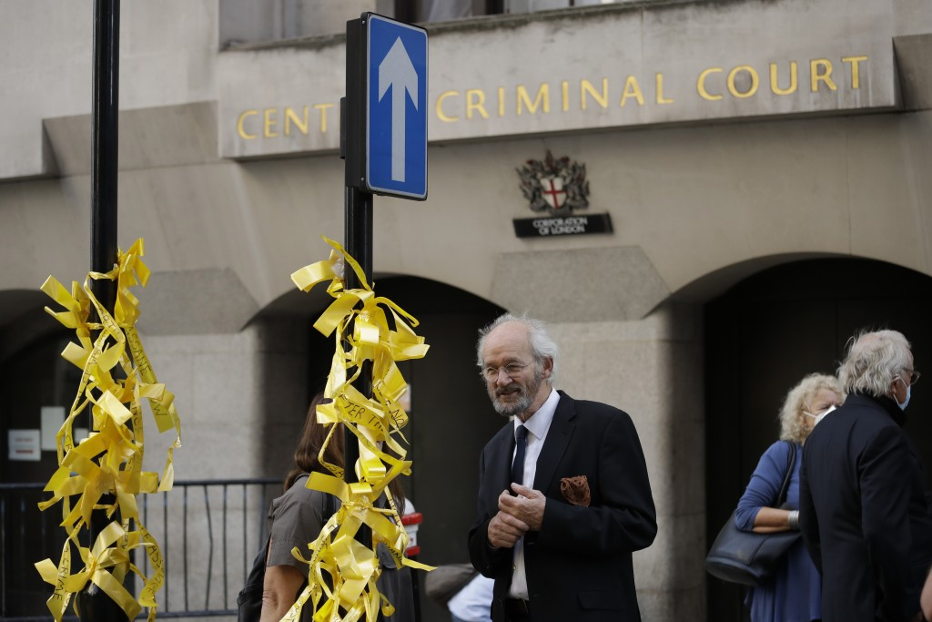 John Shipton, the father of WikiLeaks founder Julian Assange, looks at ribbons tied to a street sign by a supporter of his son outside the Central Cri...