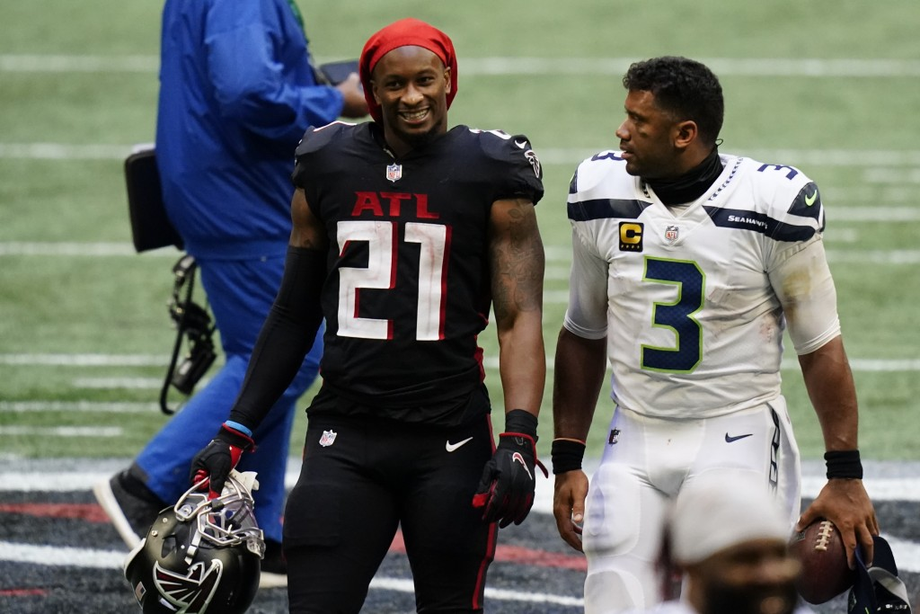 Atlanta Falcons running back Todd Gurley, left, speaks with Seattle Seahawks quarterback Russell Wilson after the second half of an NFL football game,...