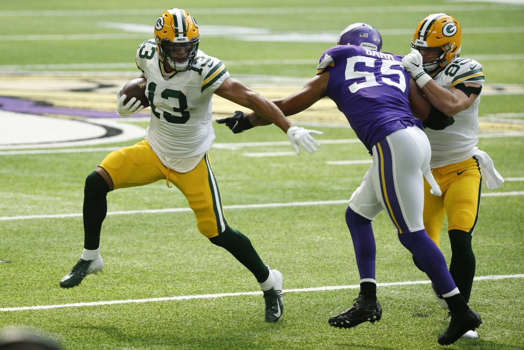 Green Bay Packers wide receiver Allen Lazard (13) runs from Minnesota Vikings outside linebacker Anthony Barr (55) during the first half of an NFL foo...