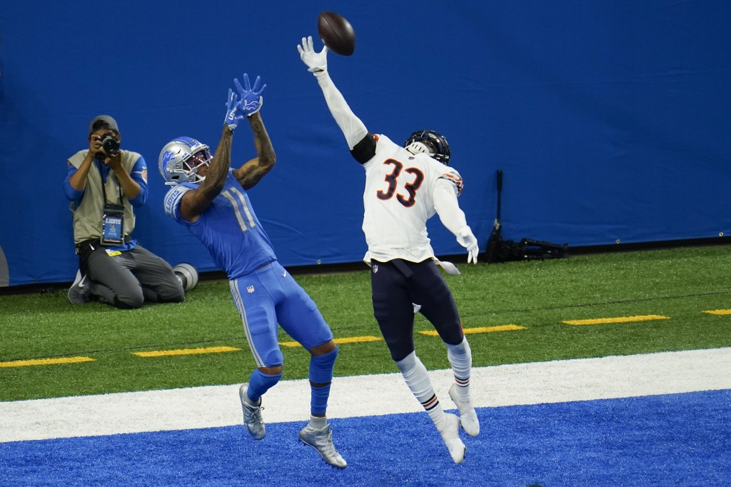 Chicago Bears cornerback Jaylon Johnson (33) breaks up a pass intended for Detroit Lions wide receiver Marvin Jones (11) in the end zone in the fourth...