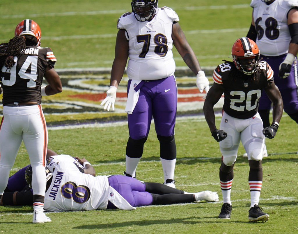 Cleveland Browns cornerback Tavierre Thomas (20) reacts after sacking Baltimore Ravens quarterback Lamar Jackson (8), during the second half of an NFL...
