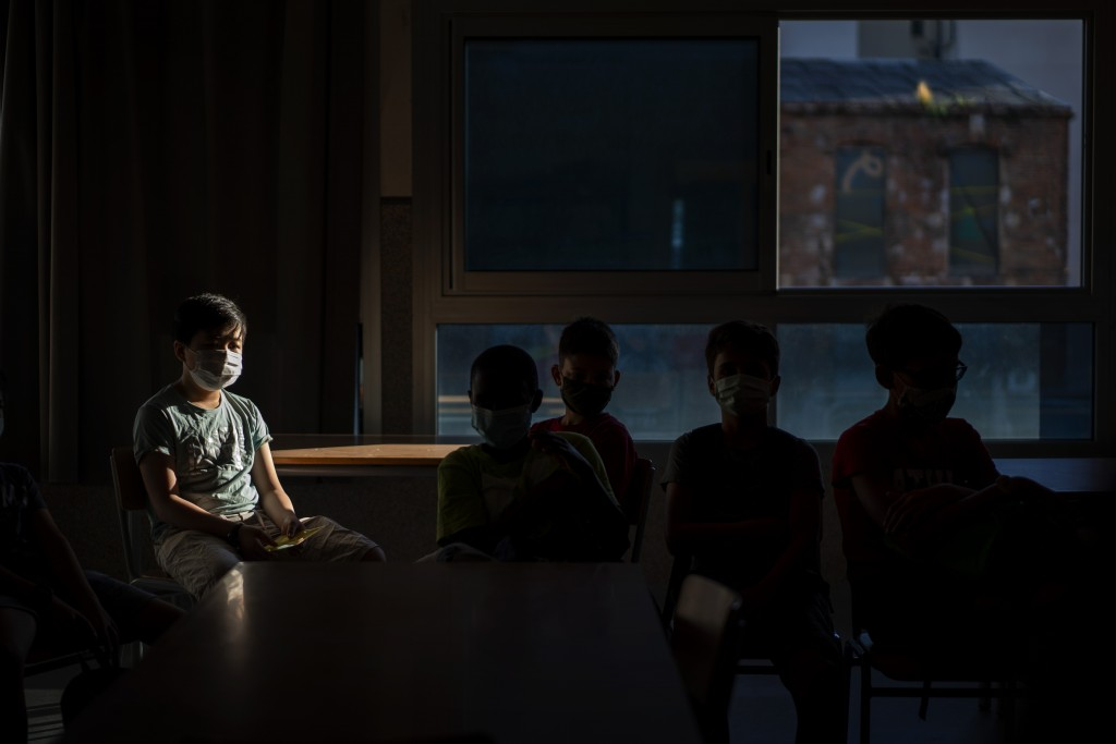 Students wearing face masks to prevent the spread of coronavirus sit in their classroom in a school in Barcelona, Spain, Monday, Sept. 14, 2020. (AP P...
