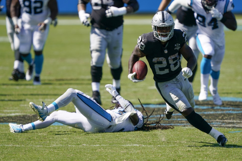 Las Vegas Raiders running back Josh Jacobs runs against the Carolina Panthers during the second half of an NFL football game Sunday, Sept. 13, 2020, i...