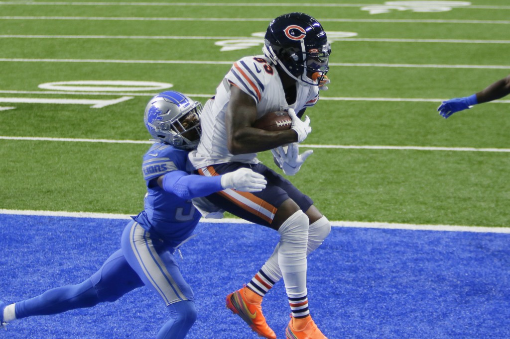 Chicago Bears wide receiver Javon Wims (83) catches a one-yard touchdown pass as Detroit Lions cornerback Tony McRae (34) defends in the second half o...