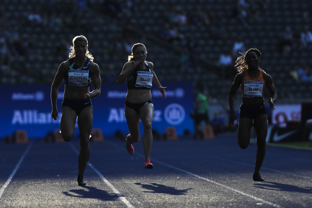 Dafne Schippers, left, of the Netherlands competes in the women 100 meters at the ISTAF Athletics Meeting in Berlin, Germany, Sunday, Sept. 13, 2020. ...