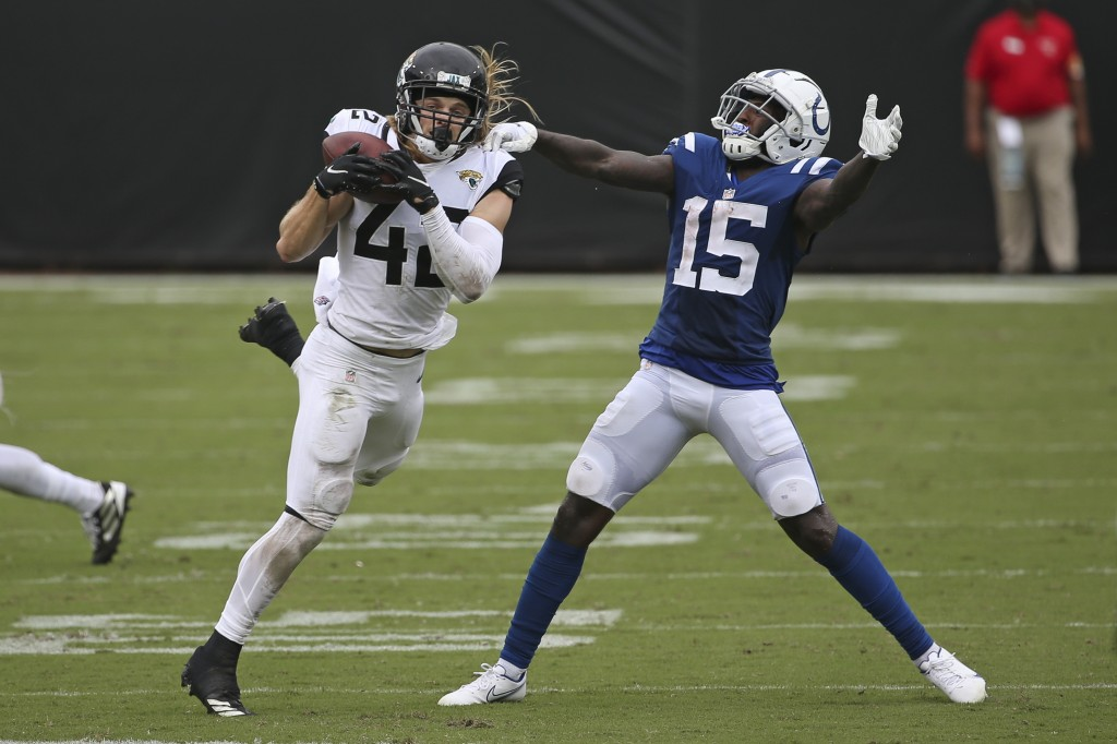 Jacksonville Jaguars safety Andrew Wingard, left, intercepts a pass in front of Indianapolis Colts wide receiver Parris Campbell (15) during the secon...
