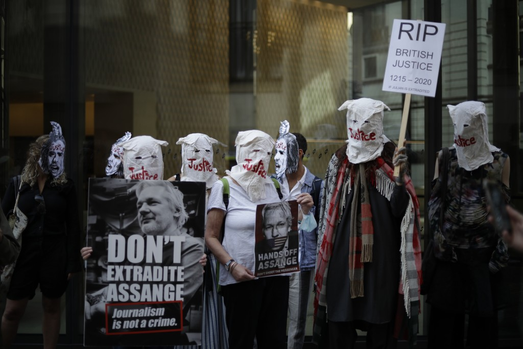 Supporters of WikiLeaks founder Julian Assange take part in a protest outside the Central Criminal Court, the Old Bailey, in London, Monday, Sept. 14,...