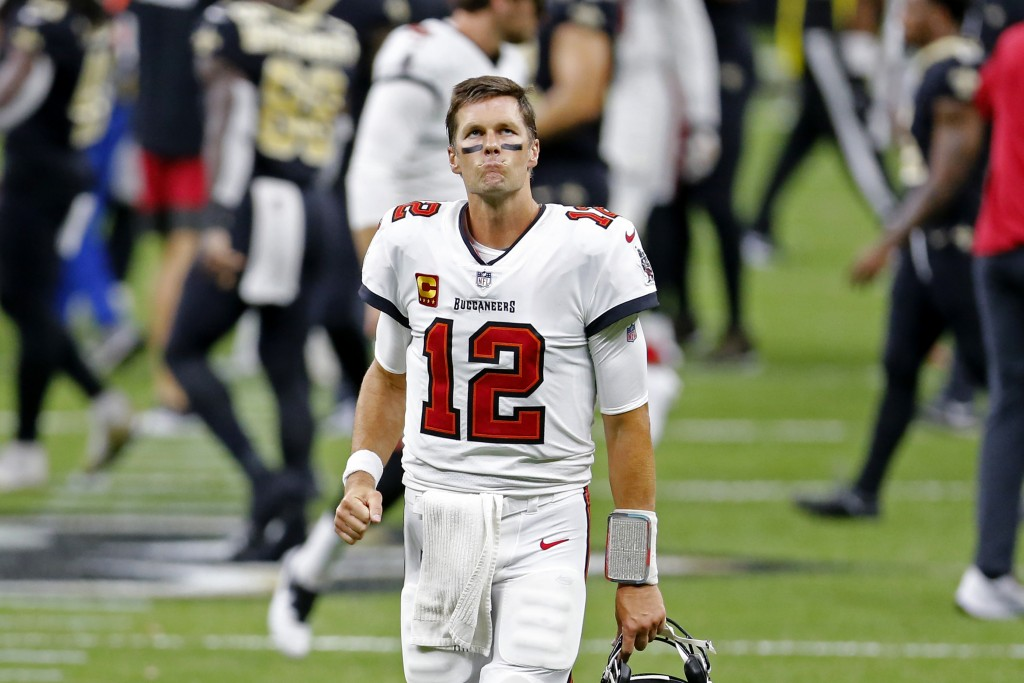 Tampa Bay Buccaneers quarterback Tom Brady (12) reacts after an NFL football game against the New Orleans Saints in New Orleans, Sunday, Sept. 13, 202...