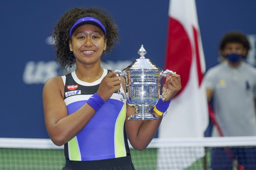 FILE - In this Sept. 12, 2020, file photo, Naomi Osaka, of Japan, holds up the championship trophy after defeating Victoria Azarenka, of Belarus, in t...