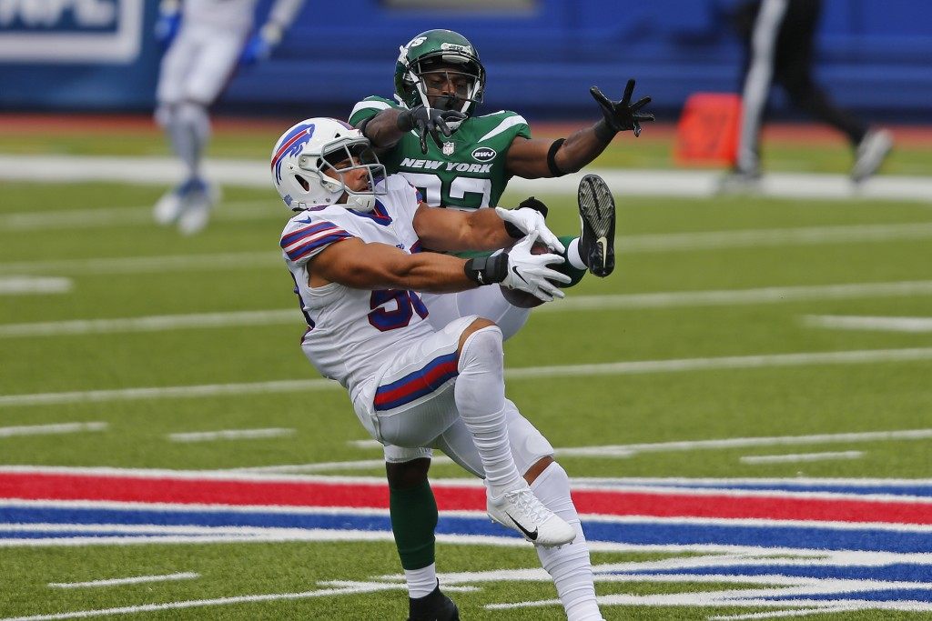 Buffalo Bills outside linebacker Matt Milano (58) intercepts a pass intended for New York Jets wide receiver Jamison Crowder (82) during the first hal...