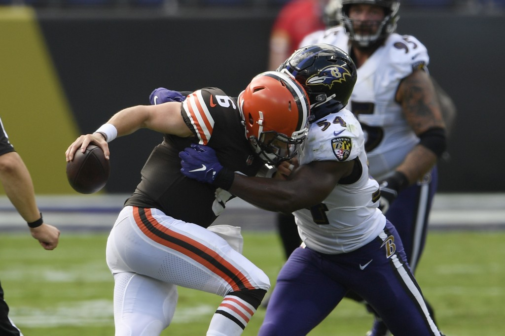 Baltimore Ravens linebacker Tyus Bowser (54) sacks Cleveland Browns quarterback Baker Mayfield (6), during the second half of an NFL football game, Su...