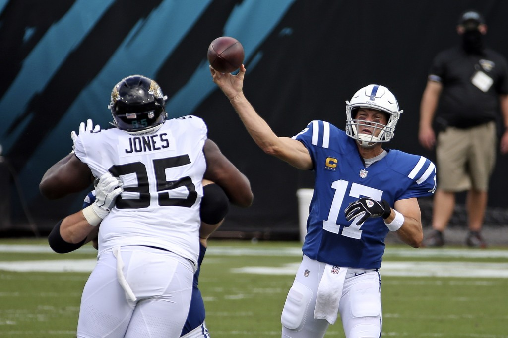 Indianapolis Colts quarterback Philip Rivers (17) throws a pass over Jacksonville Jaguars defensive tackle Abry Jones (95) during the first half of an...