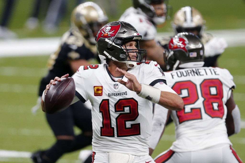 Tampa Bay Buccaneers quarterback Tom Brady (12) passes in the second half of an NFL football game against the New Orleans Saints in New Orleans, Sunda...