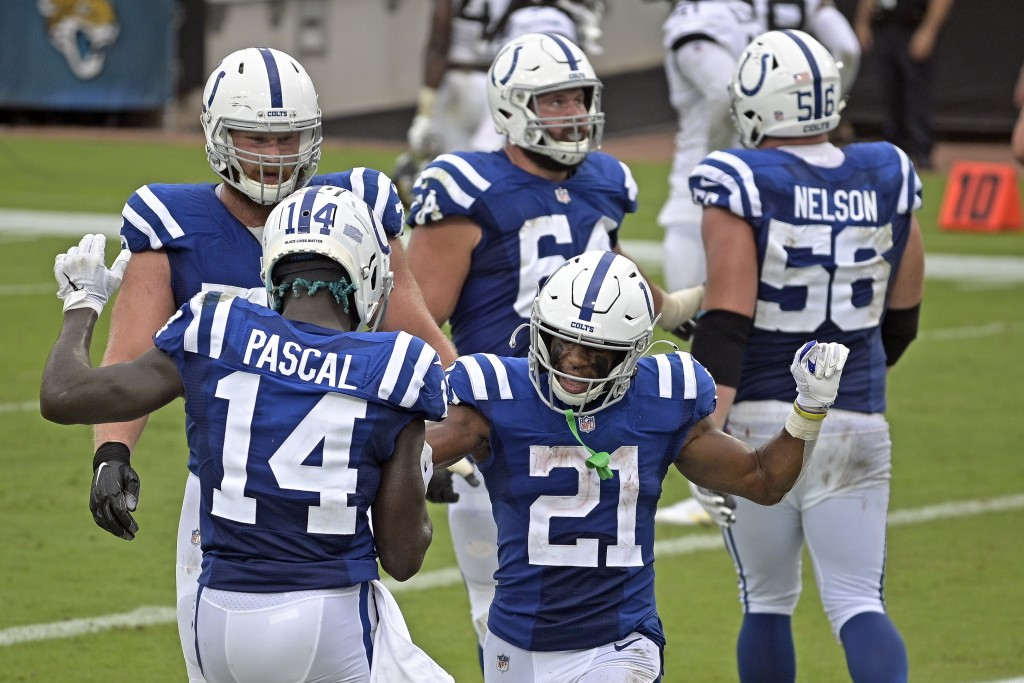 Indianapolis Colts running back Nyheim Hines (21) celebrates his touchdown against the Jacksonville Jaguars with teammate wide receiver Zach Pascal (1...