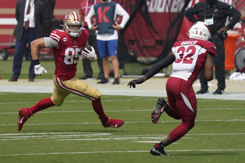 San Francisco 49ers tight end George Kittle (85) runs against Arizona Cardinals strong safety Budda Baker (32) during the first half of an NFL footbal...