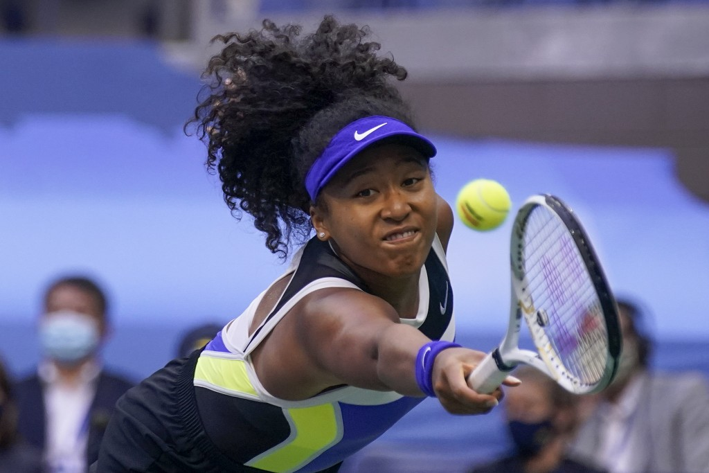 FILE - In this Sept. 12, 2020, file photo, Naomi Osaka, of Japan, returns a shot to Victoria Azarenka, of Belarus, during the women's singles final of...