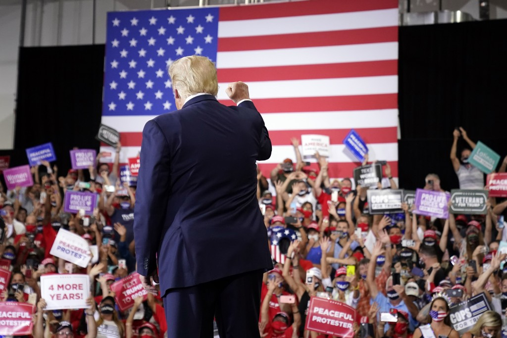 President Donald Trump arrives to speak at a rally at Xtreme Manufacturing, Sunday, Sept. 13, 2020, in Henderson, Nev. (AP Photo/Andrew Harnik)