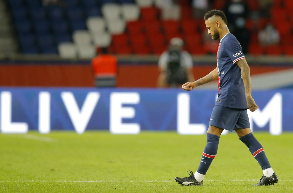 PSG???s Neymar leaves the pitch after getting a red card during the French League One soccer match between Paris Saint-Germain and Marseille at the Pa...