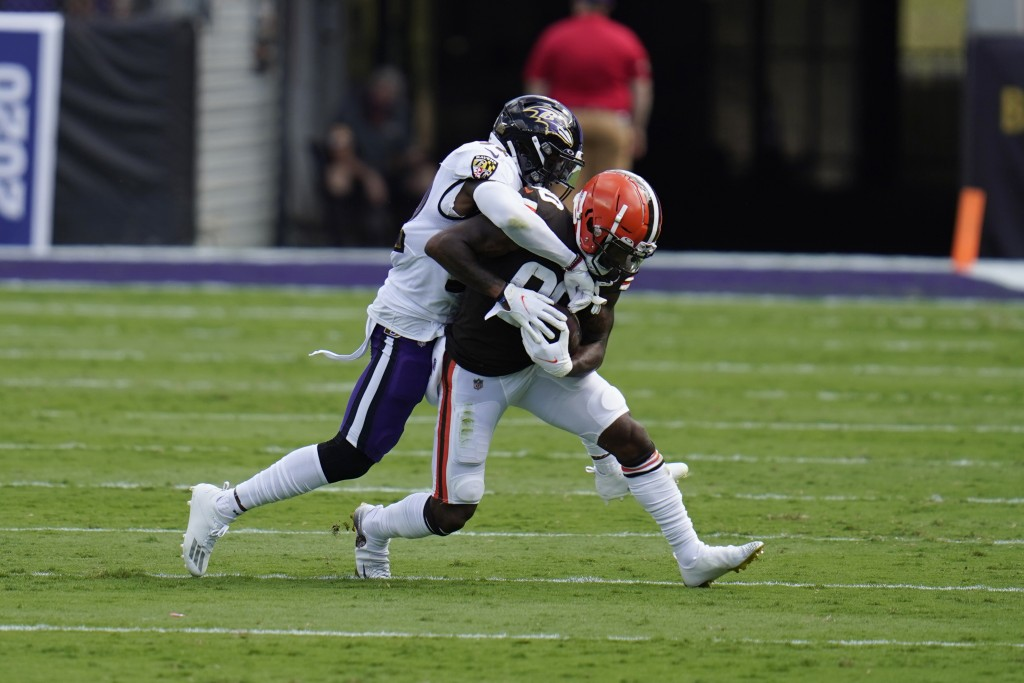 Baltimore Ravens safety DeShon Elliott (32) tackles Cleveland Browns wide receiver Jarvis Landry (80), during the first half of an NFL football game, ...