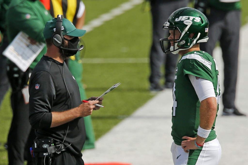 New York Jets head coach Adam Gase, left, talks with quarterback Sam Darnold during the second half of an NFL football game against the Buffalo Bills ...