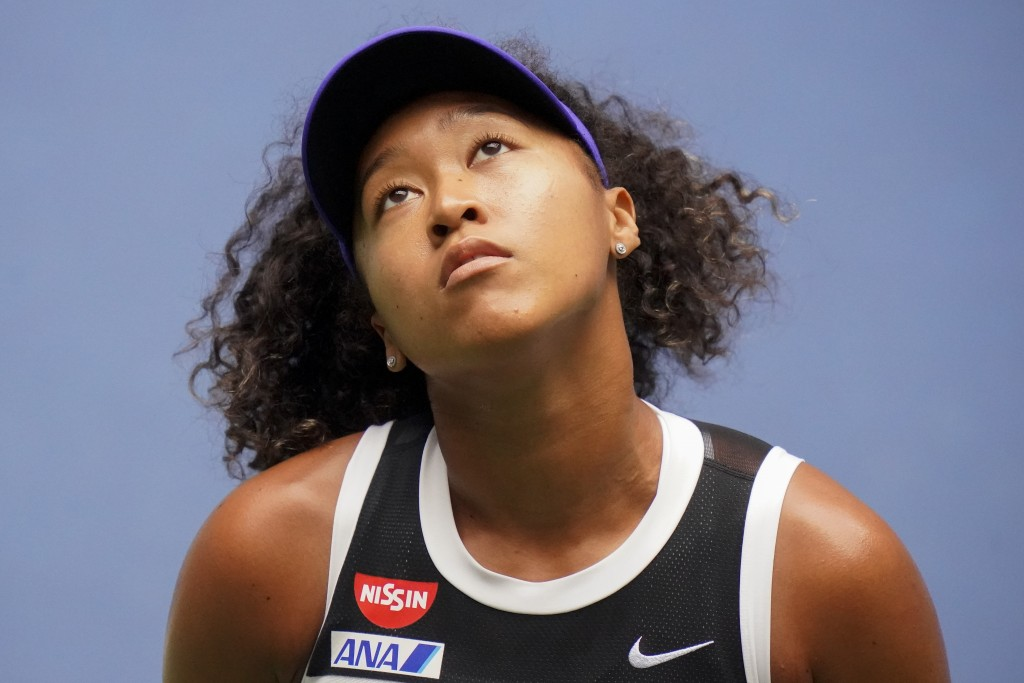 FILE - In this Sept. 12, 2020, file photo, Naomi Osaka, of Japan, reacts during the women's singles final against Victoria Azarenka, of Belarus, durin...