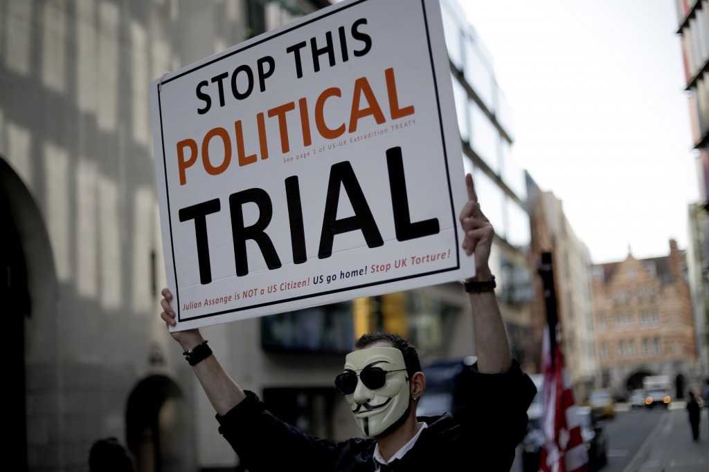 A supporters of WikiLeaks founder Julian Assange takes part in a protest outside the Central Criminal Court, the Old Bailey, in London, Monday, Sept. ...