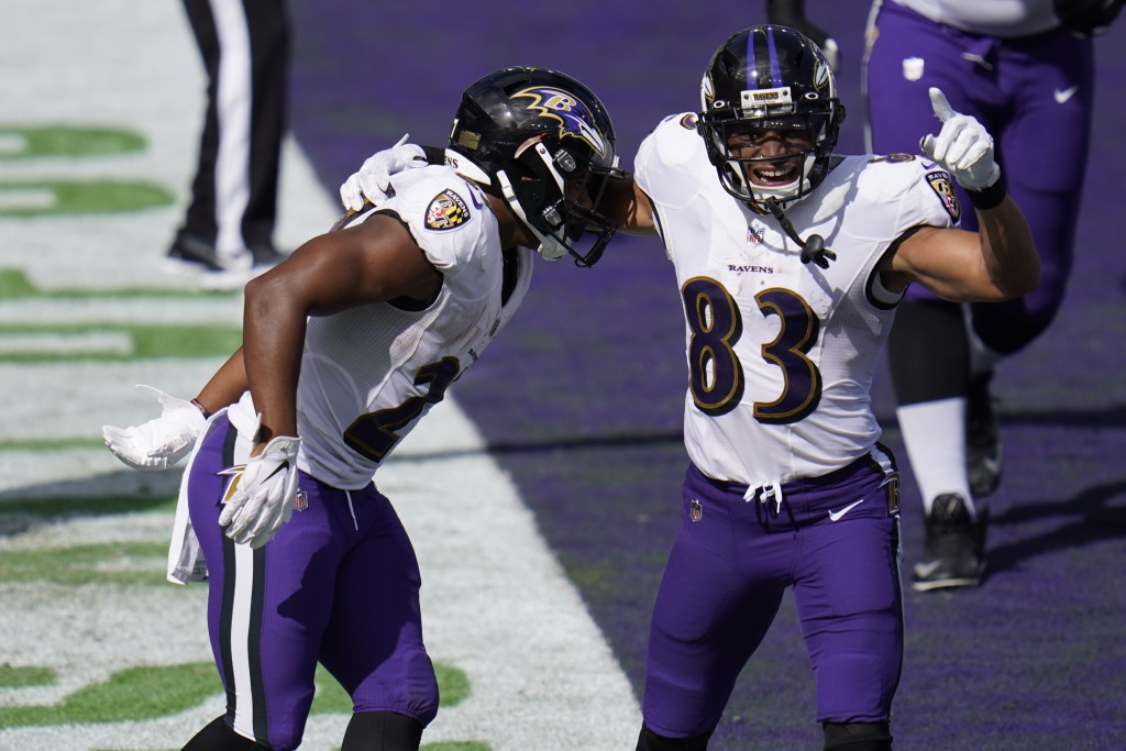 Baltimore Ravens wide receiver Willie Snead (83) celebrates a touchdown by Baltimore Ravens running back J.K. Dobbins (27), during the second half of ...