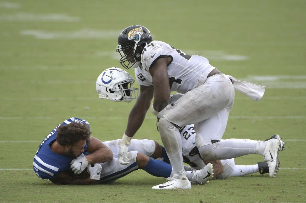 Indianapolis Colts wide receiver Michael Pittman loses his helmet after he was tackled by Jacksonville Jaguars middle linebacker Myles Jack and corner...