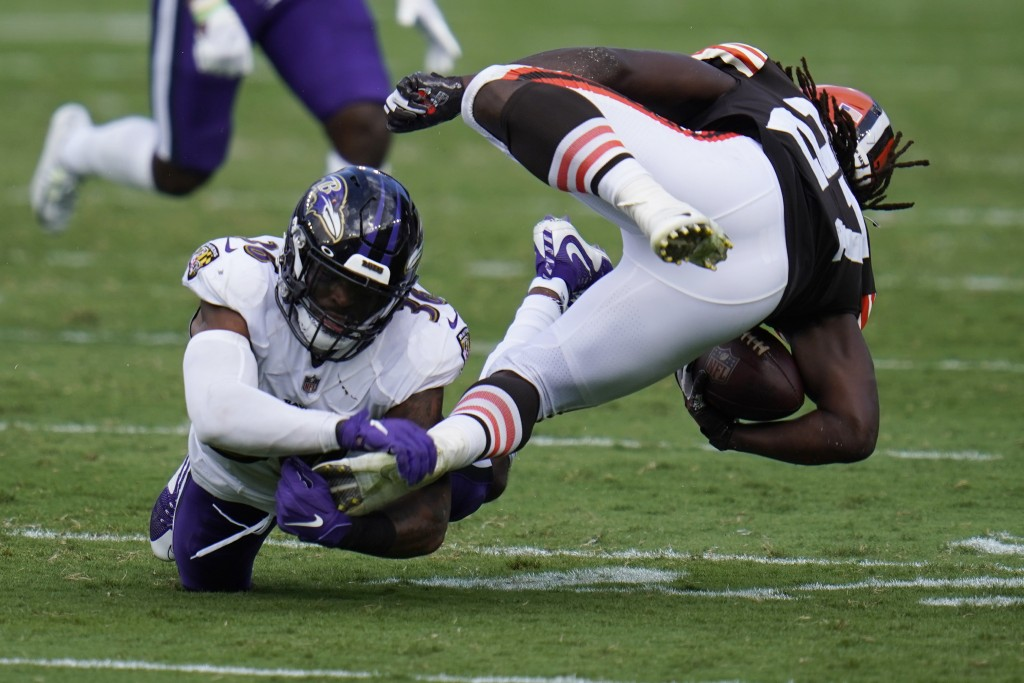 Baltimore Ravens safety Chuck Clark (36) grabs Cleveland Browns running back Kareem Hunt's (27) foot, during the second half of an NFL football game, ...