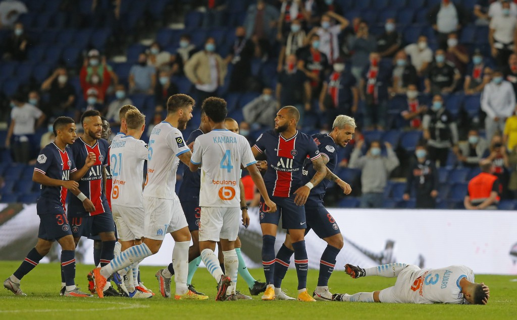 PSG and Marseille players clash near the end of the French League One soccer match between Paris Saint-Germain and Marseille at the Parc des Princes i...