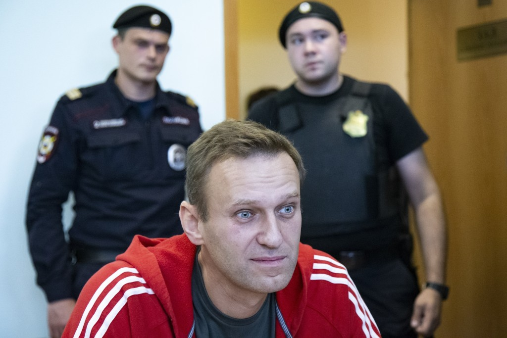 FILE- In this file photo taken on Thursday, Aug. 22, 2019, Russian opposition leader Alexei Navalny speaks to the media prior to a court session in Mo...