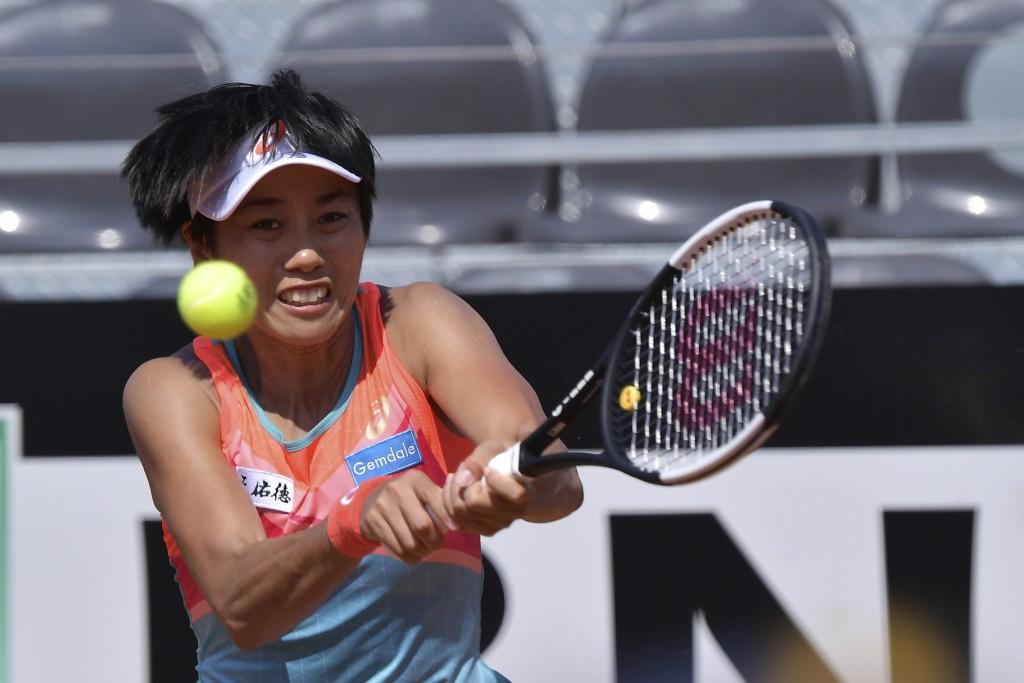 China's Zhang Shuai returns the ball to Russia's Anastasia Pavlyuchenkova during their match at the Italian Open tennis tournament, in Rome, Monday, S...