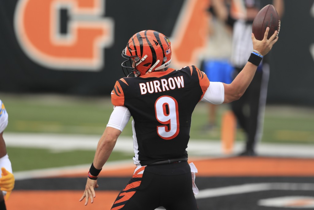 Cincinnati Bengals quarterback Joe Burrow (9) reacts after running for a touchdown during the first half of an NFL football game against the Los Angel...
