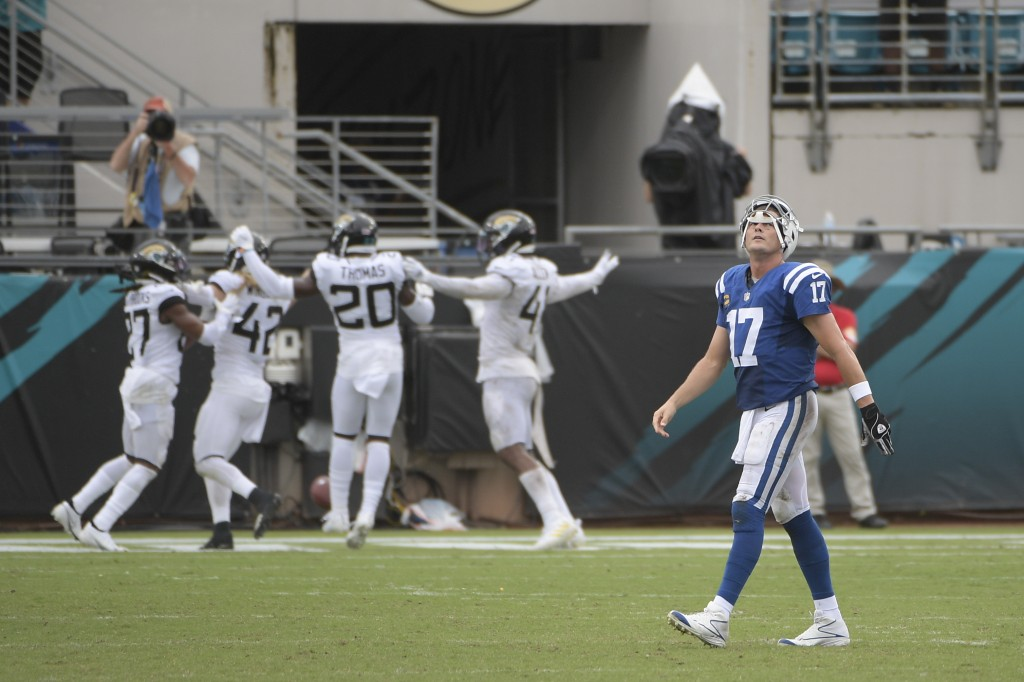 Indianapolis Colts quarterback Philip Rivers (17) walks off the field after the Jacksonville Jaguars intercepted a pass he threw during the second hal...