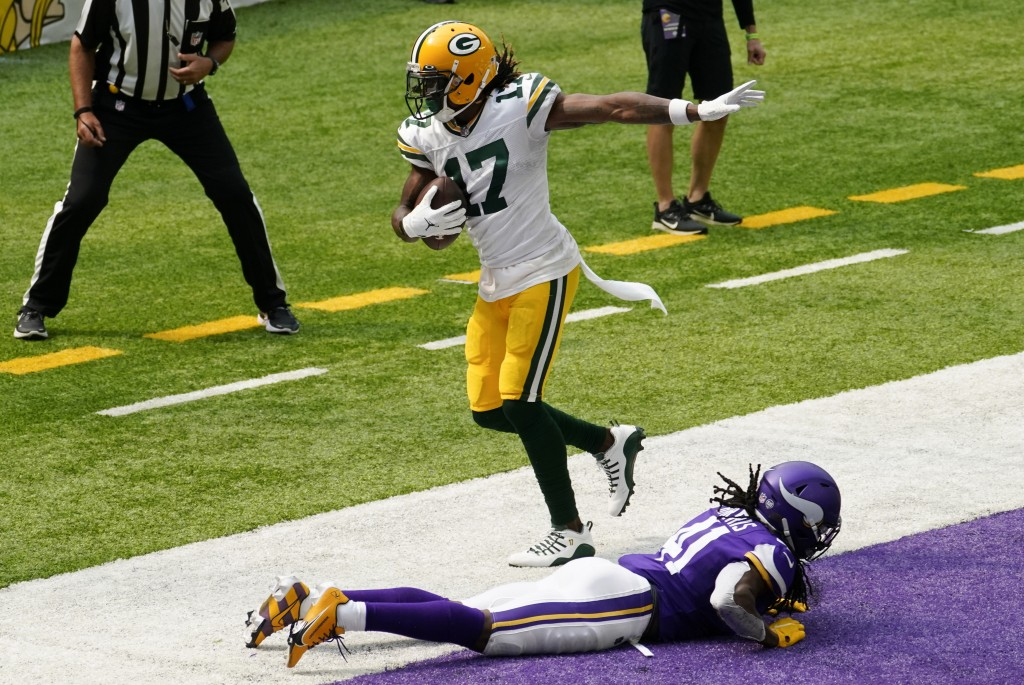 Green Bay Packers wide receiver Davante Adams (17) catches a 24-yard touchdown pass over Minnesota Vikings defensive back Anthony Harris during the fi...