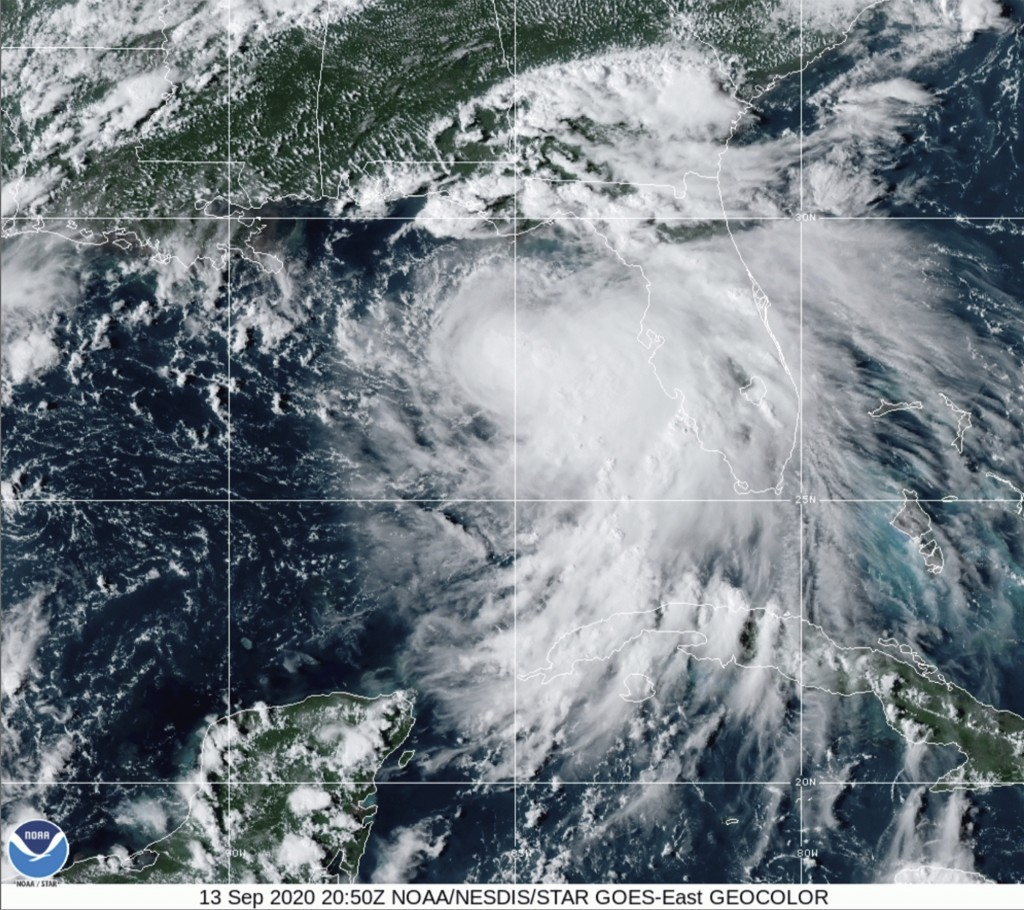 This satellite photo provided by the National Oceanic and Atmospheric Administration shows Tropical Storm Sally, Sunday, Sept. 13, 2020, at 2050 GMT. ...
